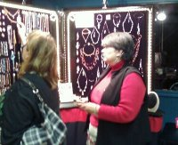 Laura helps a guest browse the wonderful jewelry
